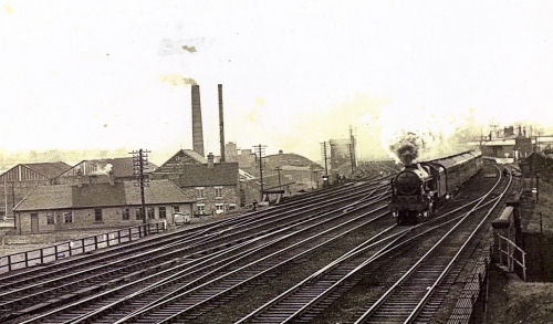 Image: picture of steam engine on tracks of busy junction